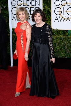 Jane Fonda, in Versace, with Jimmy Choo shoes, and Lily Tomlin. The 2015 Golden Globe Awards: Live From the Red Carpet - Gallery - Style.com