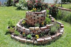 Herb spiral tutorial: To create an herb spiral, use stone slabs or large rocks to build a stone wall by dry-stacking stones into a loose spiral that rises toward the center. Fill the interior of the spiral with soil and pack additional soil around the outer edge. Plant herbs that require sun and good drainage – like oregano, thyme, lavender, and rosemary – near the top. In the middle, plant herbs...