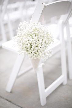 Baby's Breath wedding chair decoration orlandoweddingflowers/ www.weddingsbycar...