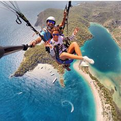 Couple parasailing aerial view