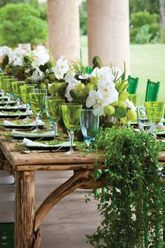 Bella Flora of Dallas, Crisp Green and White Dinner Reception Table with white phalaenopsis orchids, asclepia pods