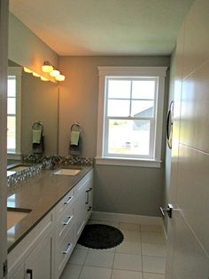 Grey counter love it with the white cabinet.  Misty by Sherwin Williams - bathroom paint color