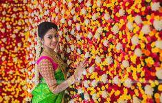 South Indian bride. Gold temple jewelry. Jhumkis.Green kanchipuram sari with contrast pink blouse.Braid with fresh jasmine flowers. Tamil bride. Telugu bride. Kannada bride. Hindu bride. Malayalee bride.Kerala bride.South Indian wedding: