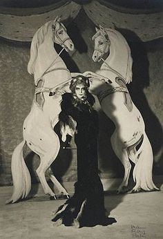 """Marchesa Casati was an eccentric Italian heiress, muse, and patroness of the arts in early 20th century Europe. As the concept of dandy was expanded to include women, the marchesa Casati fitted the utmost female example by saying: """"I want to be a living work of art""""."""