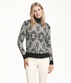 Jacquard-knit turtleneck sweater in a wool blend. Long sleeves, rib-knit collar, and ribbing at cuffs and hem.