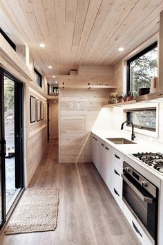 The tiny home is clad in a stunning maintenance-free black corrugated metal siding. Twelve windows and a sliding glass door allow for plentiful natural light. tiny homes Draper by Land Ark - Tiny Living Tiny House Plans, Tiny House On Wheels, Tiny House Trailer, Tiny Houses For Sale, Tiny House Living, Living Room, Tiny House Kitchens, Modern Tiny House, Tiny House Luxury