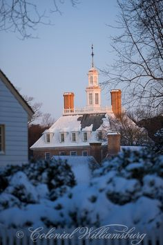 Governor's Palace at sunrise. Winter snow in Colonial Williamsburg's Historic Area. Williamsburg, Virginia. Photo by David M. Doody