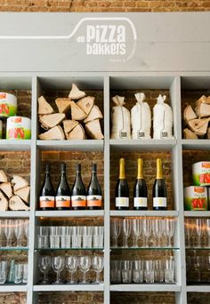 Open shelves on brick. De Pizzabakkers | Haarlem, Netherlands