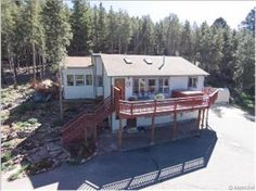 www.8892Martin.com<br/>Stunning  180 degree views of mountains and National Forest, built in 1998 and added on in 2002, south facing bright open Great Room floor plan with vaulted ceilings and skylights, large Trex style deck with a hot tub that has the best views and stargazing, paved driveway, terraced gardens, newer slab granite kitchen with new stainless steel appliances, master suite retreat with fireplace and 5 piece bath, fully fenced yard, interior workshop and storage space, and so…