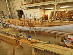 Steaming the Inwale -- The inwale is steamed and bent on the outside of the boat while the molds are still in place, in essence using the boat as a bending jig. After the frames are installed and the molds are removed, the shaped inwale will be installed inside the boat.