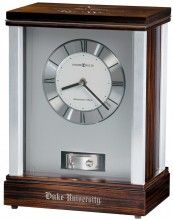 This mantel clock features brushed aluminum corners and polished silver-tone accents. A unique, revolving pendulum is located under the dial and finished in a polished silver-tone. Quartz, battery-operated movement plays Westminster chimes on the hour.Requires 2 AA and 2 C batteries (not included). #duke #university #alumni #grad #graduation #present #gift #personalized #custom #clock