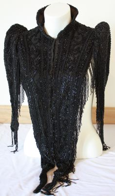 This piece is a black hand-beaded over-blouse donated by Mrs. A Roberts. This beautiful piece has mutton sleeves and a nehru-styled collar. This piece was work around the To see more fantastic fashion pieces check out the Huron County Museum! Huron County, Beautiful Women, Museum, Blouse, Lace, Check, Womens Fashion, Sleeves, Clothes