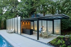 This pool pavilion has a lovely asian influence, in a modern articulation.