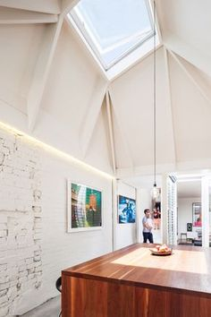 Two angular skylights funnel daylight into a kitchen and dining area at the rear of this renovated house in Sydney by local office Carter Williamson Architects