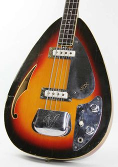 Extra cool and rare 1966 Vox Wyman Bass in a aged and checked  Sunburst finish. Don't see too many of these around as they were only  made for one year! Made in Italy, fully hollow body, and a super  slim/narrow neck. Overall in very good condition less some finish  checking/chipping, h...