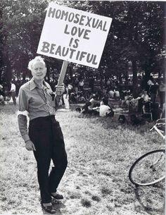 Vintage gay pride:  An older gay activist holding up a sign, 1973.