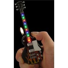 Les Paul Rock-n-Roll Light Show Guitar Lighter (Assorted) Custom Lighters, Cool Lighters, Light My Fire, Zippo Lighter, Aesthetic Grunge, Rock N Roll, Cool Things To Buy, Alcohol, Guitar