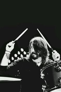Dave Grohl....amazing with either a guitar or on drums.  I prefer drums!  He kicks ass!