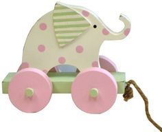 "New Arrivals Elephant Pull Toy, Pink by New Arrivals. $24.00. Old fashioned wooden pull toys never looked so cute; Perfect for playing with or use for room decor. Distressed edges. Hardwood, hand painted. Old fashioned wooden pull toys never looked so cute. Perfect for playing with or use for room decor.  Approximately 10"" by 8""."