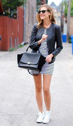 Striped tunic dress + peplum leather jacket + white converse