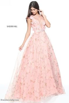 Sherri Hill 51104 is a cap sleeved prom dress with an illusion deep-v neckline, applique bodice and a printed organza full skirt.