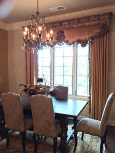 Old World Tuscan Dining room with high-end cornice and Trump Collection chandelier