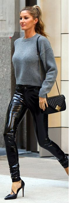 Who made Gisele Bundchen's patent pants, gray sweater, and quilted handbag?