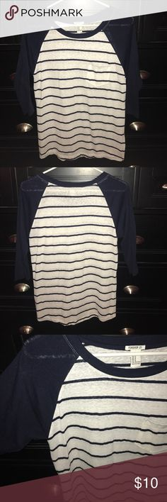 Forever 21 Striped Baseball Tee Good condition. White and black stripes with black 3/4 sleeves. Cute pocket in the front. This is so cute and comfortable on, perfect for year round and you can honestly dress this up or down! Love it Forever 21 Tops Tees - Short Sleeve