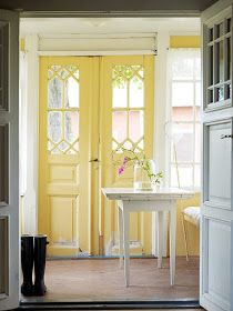 Interior door painted bright yellow.