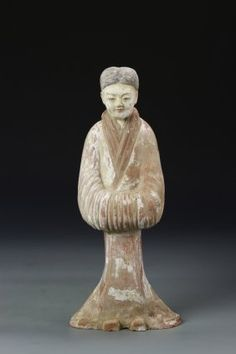China, Tang Dynasty, lady figure, in a standing position, with her hands enclosed in her sleeves, painted face and textured hair, with fading paint throughout. Height 13 1/2 in.
