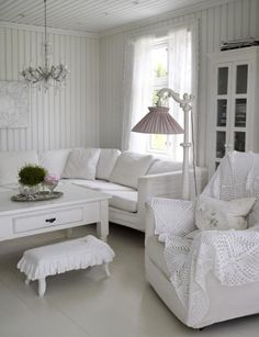 An all white, fabulously fancy living room complete with a pretty vintage floor lamp