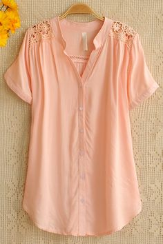 Love the color and style and how feminine this top is.