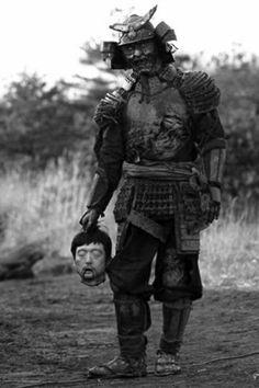 Brutal samurai warrior using fear tactics
