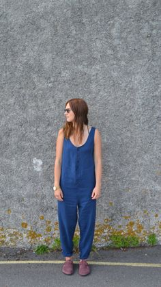 Jumpsuit in heavy blue linen, with side pockets, tapered legs and a button front. Handmade to order in Penryn, Cornwall by Phaedra Clothing. Two sizes available: Small/med: approx. 95cm (37) bust, 100cm (39) hip, 64cm from neckline-crotch, 72 cm inner leg. Med/large: approx. 115cm (45) bust, 120cm (47) hip, 64cm from neckline-crotch, 72cm inner leg. The model shown here is 58, has 34 bust and is a size 8-10. Machine dyed.