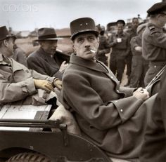 WWII. The French general Charles de Gaulle (1890-1970) in a jeep few days after the Invasion of Normandy by the Allied forces. June 14, 1944. Coloured photograph.