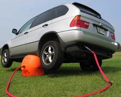 Exhaust powered inflatable car jack.