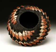 """Rust & Black"": Handcrafted, coiled basket of dyed and natural Broomcorn. Handmade, contemporary and traditional inspired by the natural world. Woven with indigenous materials, hand gathered and prepared locally. Inspired by the ancient basketry craft of the Papago and Pima tribes.. 10"" X 8"""