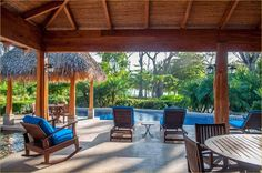 The large villa great room overlooks the pool, lounge areas and Pacific Ocean on Santa Teresa's golden sand beaches.