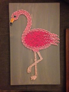 This approximately 12 by 18 board is stained in dark grey. The Flamingo is strung in both light and dark pink. The eyes and beak is black. The legs are a very light pink. patriotic addition to your home! This board currently does not have any hanging hardware attached. If you would like hanging hardware, please add that in note to seller section. This board can be made bigger and I love custom orders. It also can be made as a made-to-order board in any color. Pricing would be the same (for…