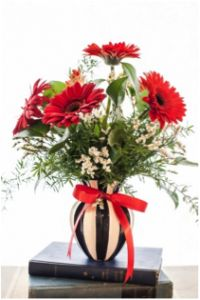 All Smiles features premium gerbera daisies in a bold striped vase sure to make a statement. #gerberdaisy #fleurdujour #grablifebythestem #valentinesday #flowers