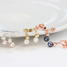 Pearl drop earrings with silver, rose gold or gold stars. In pink, white or peacock pearls and fish hooks studs or clipon for non pierced ears Pearl Drop Earrings, Star Earrings, Clip On Earrings, Jewellery Earrings, Star Jewelry, Jewelry Gifts, Silver Roses, Rose Gold, Silver Pearls
