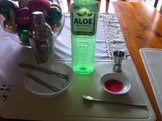 Good for kids who don't like to drink milk/water on a hot day.  Take out the old cocktail mixer and create a bar!  We kept it simple, but of course you can go all out.   -shaker and kit -shot glass/es -aloe vera juice (this can be water or milk) -a few drops of strawberry essence (you can skip this for milk - swap it for drinking chocolate or caramel) -a few drops of pink colouring (good for the water) -ice  It got my little guy to drink two big cups of juice on a ridiculously hot day!