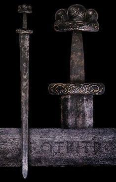 Viking Sword with gold and silver inlaid Nordic ornaments. Danish, 9th or 10th century.