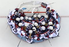 Description of . USA's players gather before the start of the Women's Ice Hockey Group A match between Canada and USA at the Sochi Winter Ol...