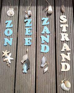 zon, zee, zand letters