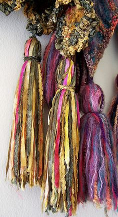 tassels with a gypsy feel...Great way to use up those scraps of eyelash yarn, and ribbons.