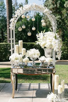 Mirrors and white flowers wedding decor