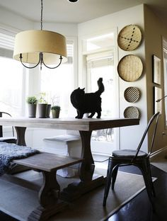 I am not a fan of naked light bulbs. I loke the idea here on the light fixture.  Interesting use of baskets too.