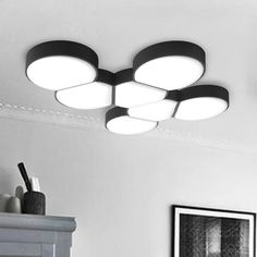Fun and cool, you will appreciate the geometric appeal of this LED flush mount ceiling light. This ceiling light comes in a black or white metal base around a delicate acrylic shade in several shapes adding modern minimalist aesthetic and geometric fun.