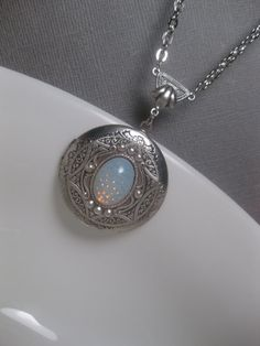 Ancient Star Locket Opal Necklace... I have always wanted a locket! Plus I love opals